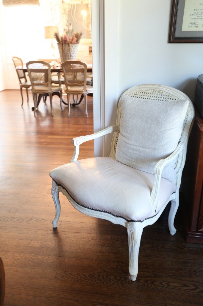 French chairs with leather seats and caned back