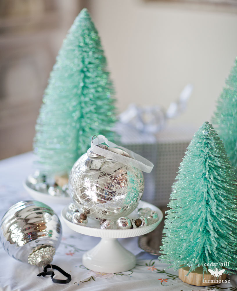 bottle-brush-trees-and-white-cake-plate