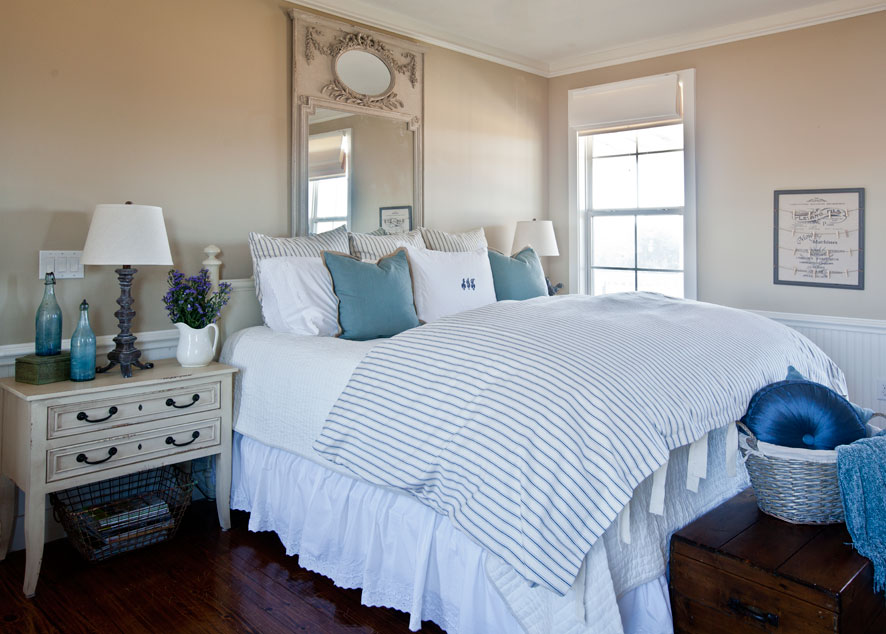 blue bed with french gray mirror