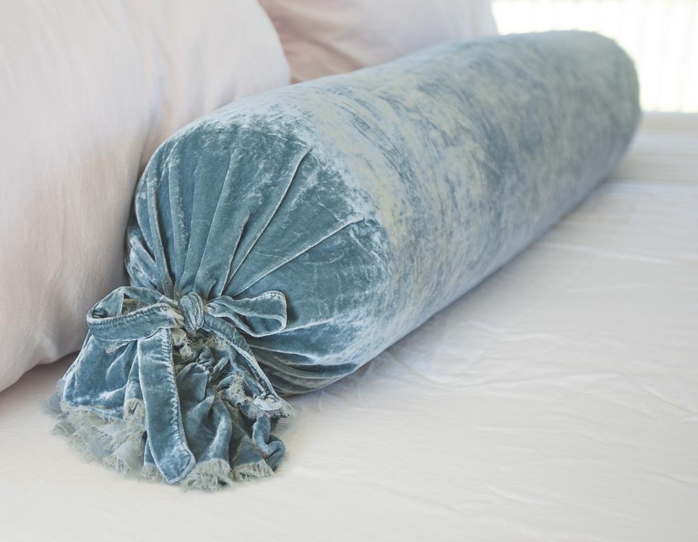 Blue velvet bolster pillow