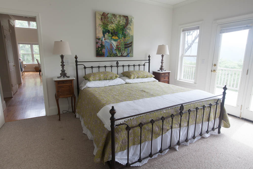 green bed mountain bedroom