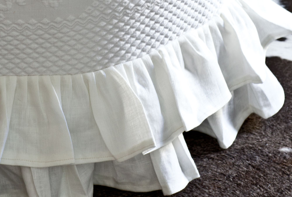 Slipcovered ottoman double ruffle
