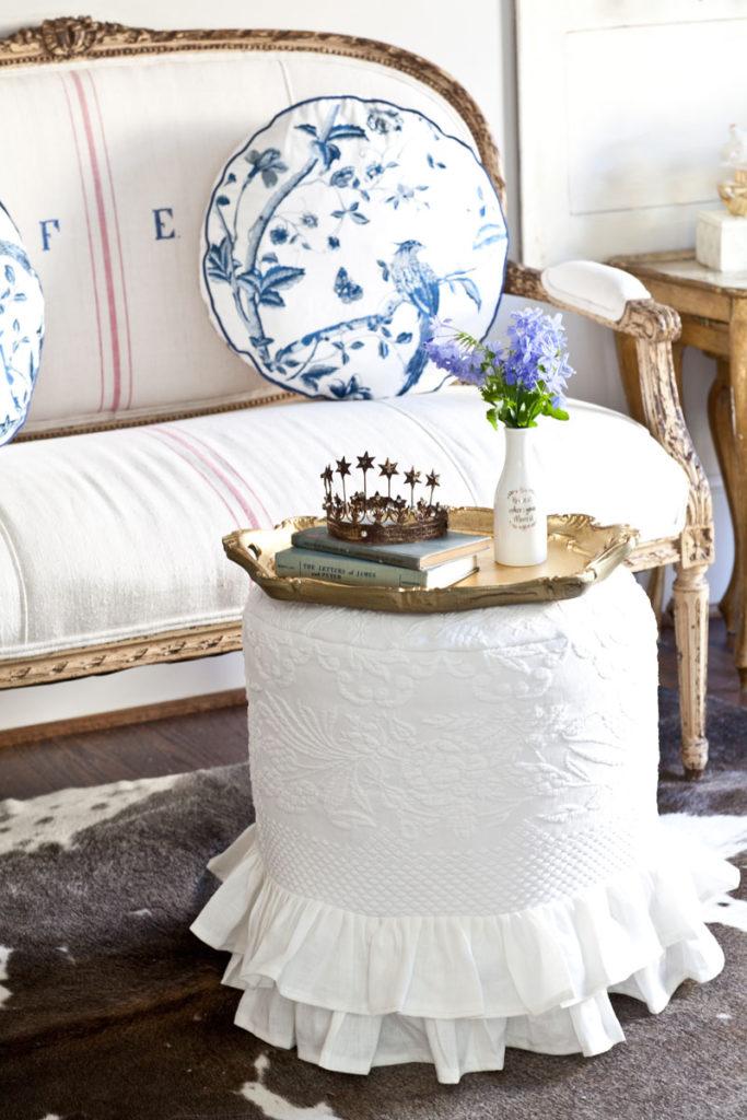 Slipcovered ottoman in white