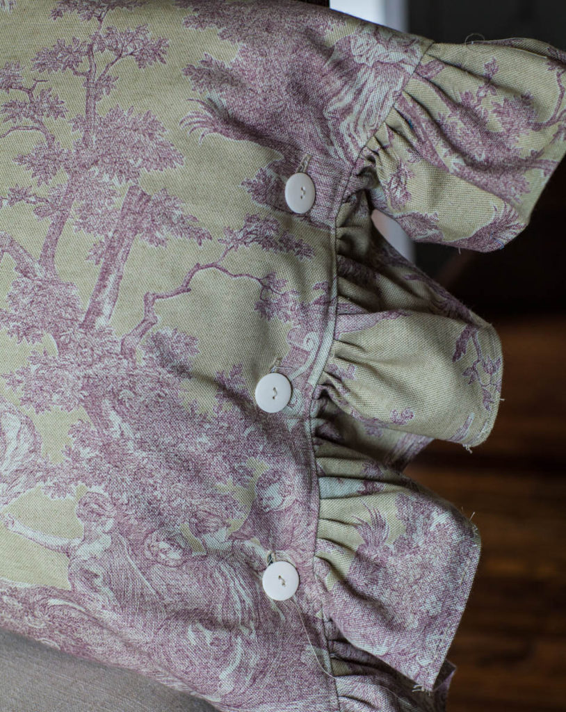 toile pillow detail