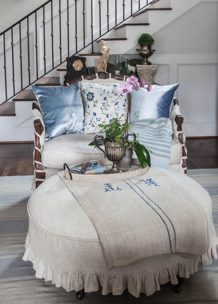 Blue ruffled slipcover and pillows