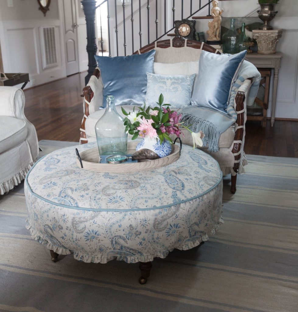 Blue ruffled slipcover and french chair