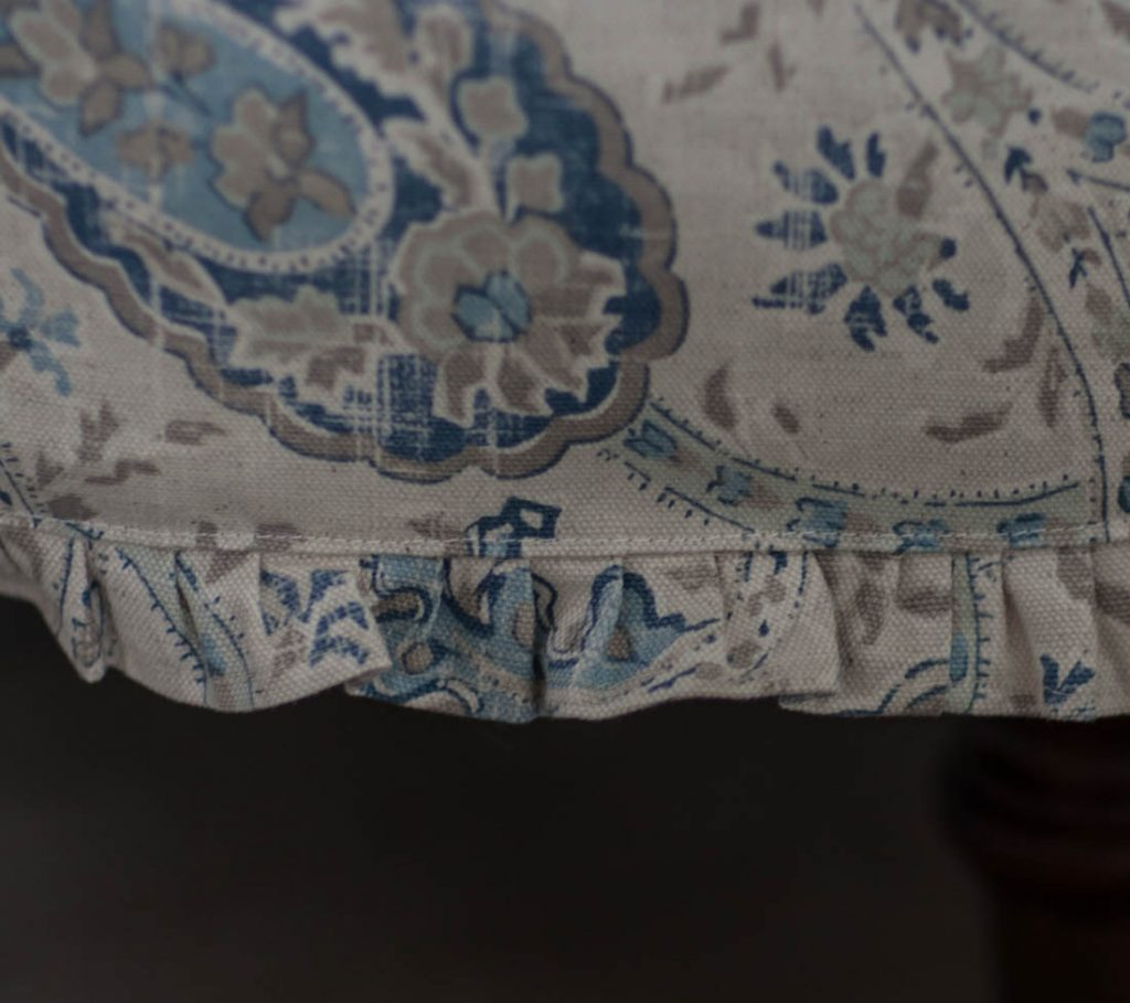 Blue ruffled slipcover detail