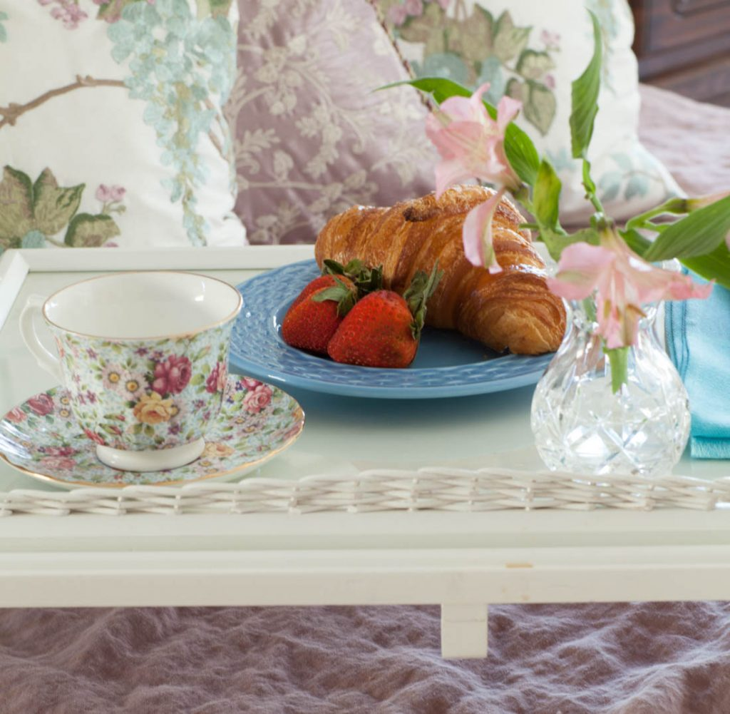 rose linen sheets and croissants