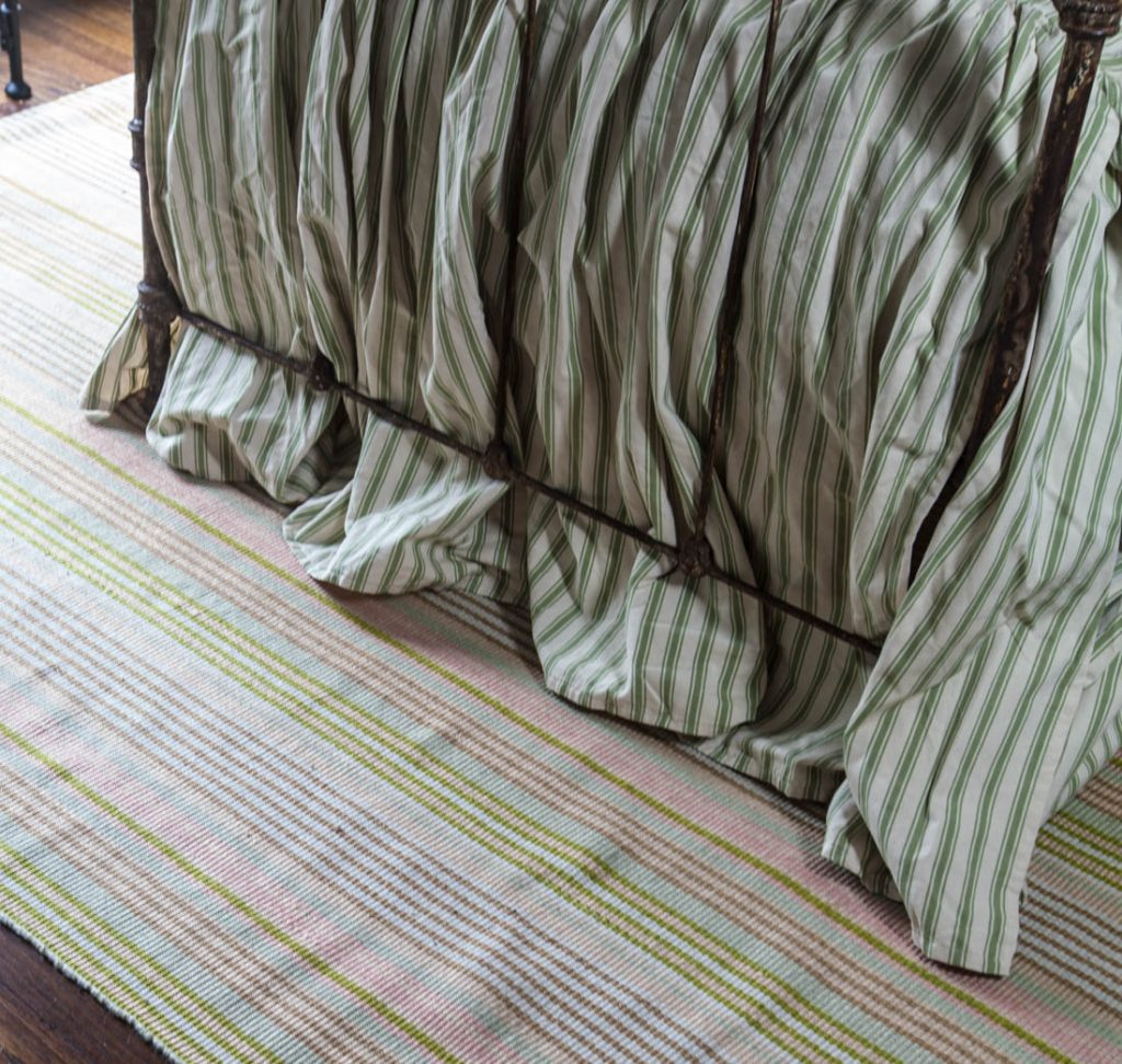 striped rug with green and pink