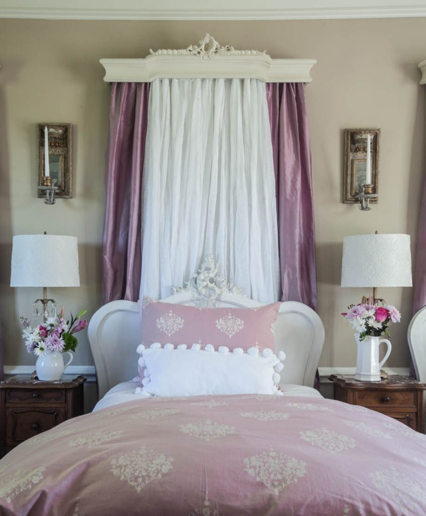 pink curtains behind bed and duvet