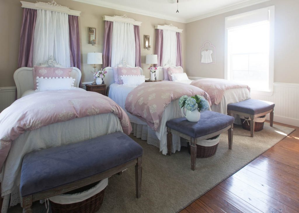 pink curtains behind bed