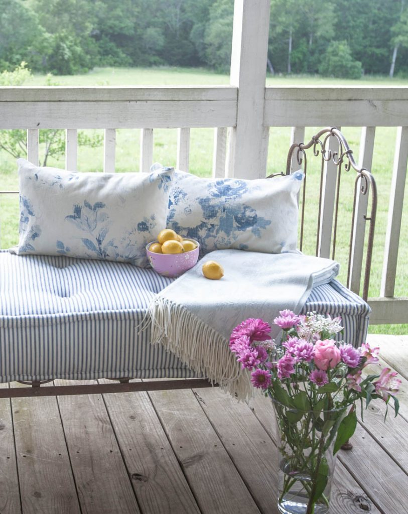 blue porch pillows and lemons